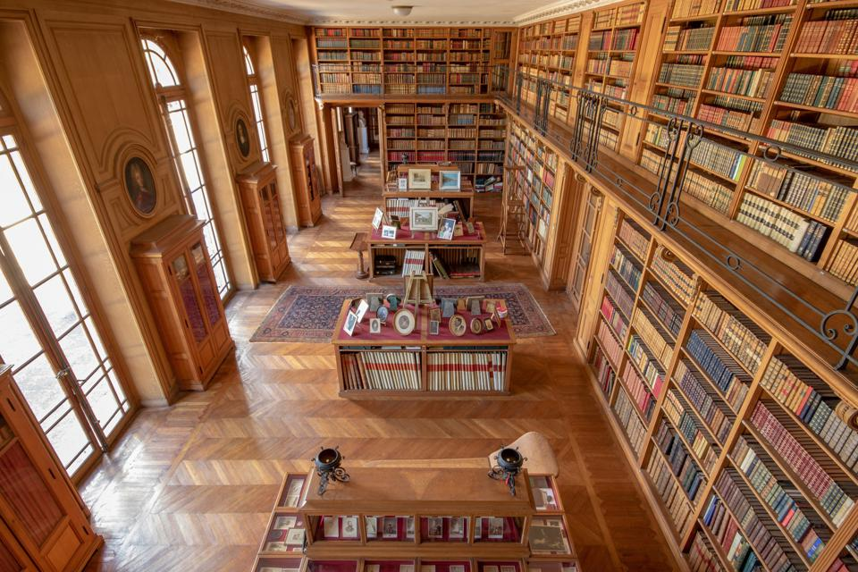 large library gallery with inlaid floors and french doors 17th Century castle