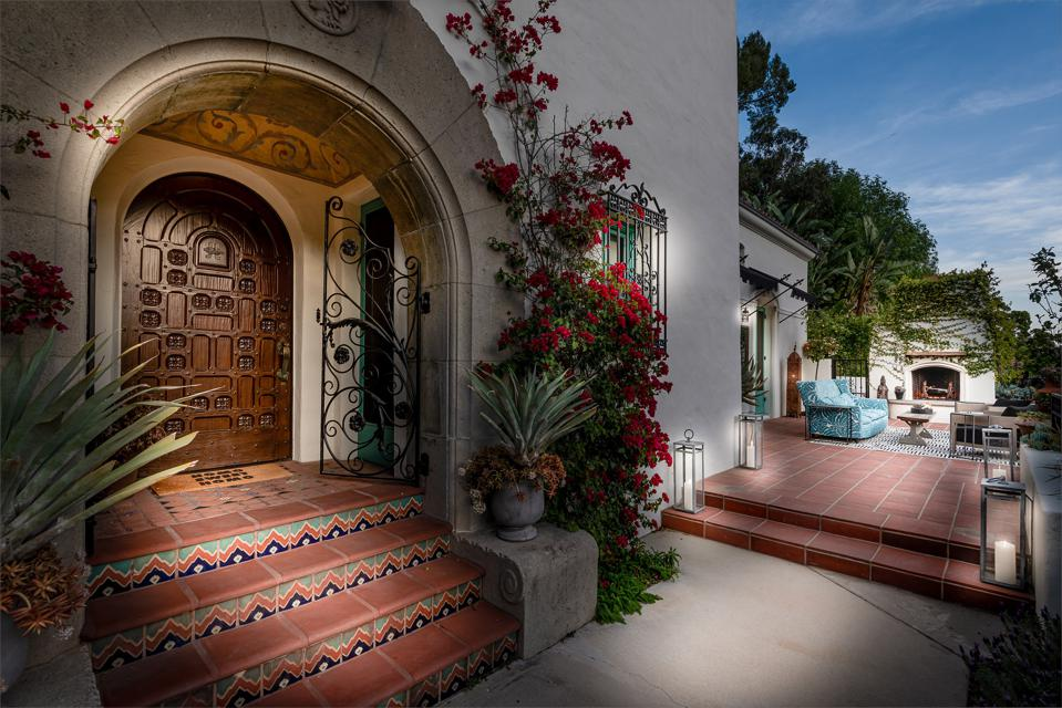 Spanish Colonial-style with a carved wooden door